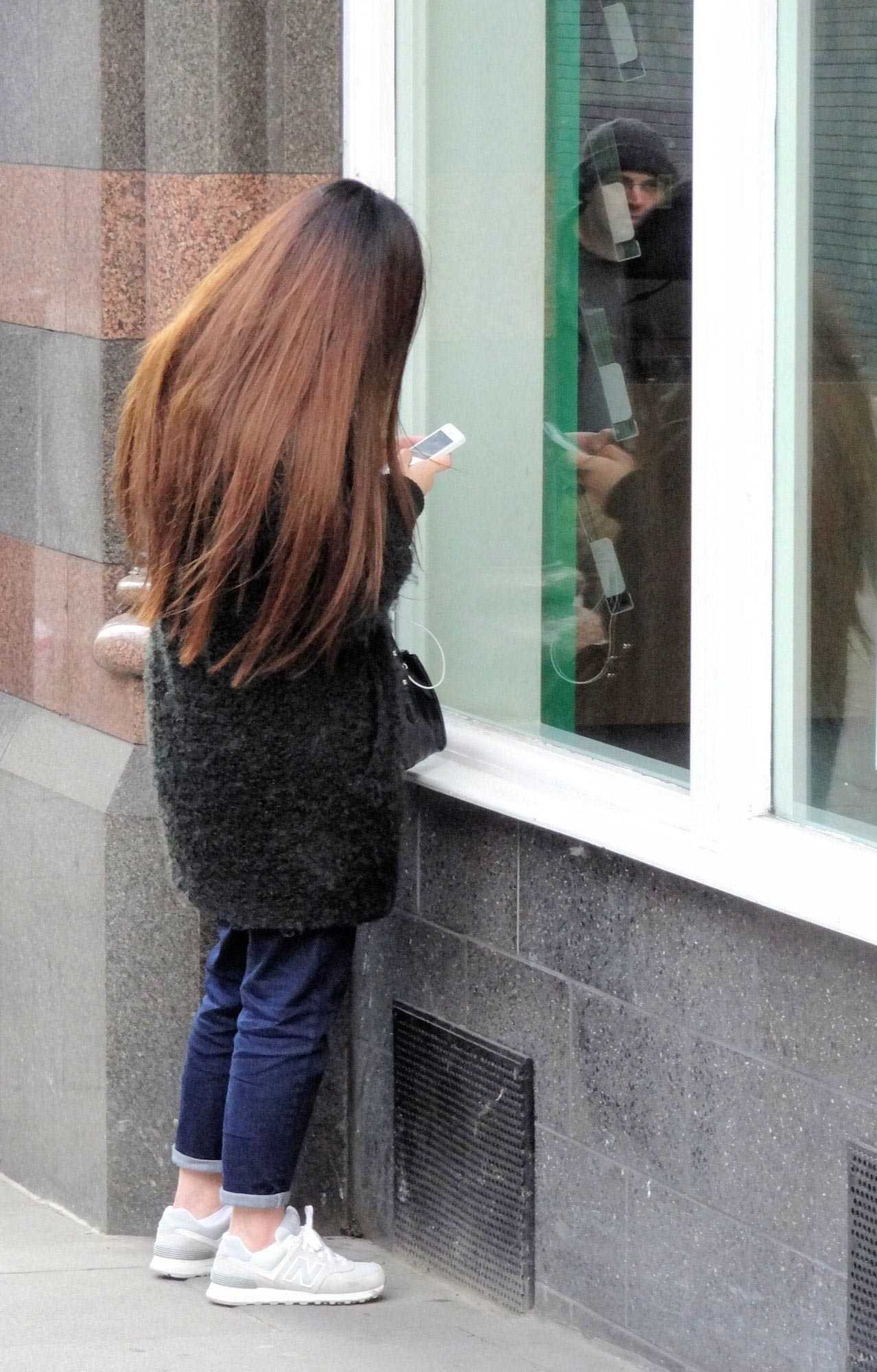 Furtive mobile phone use -> what doesn't she want the world to know?