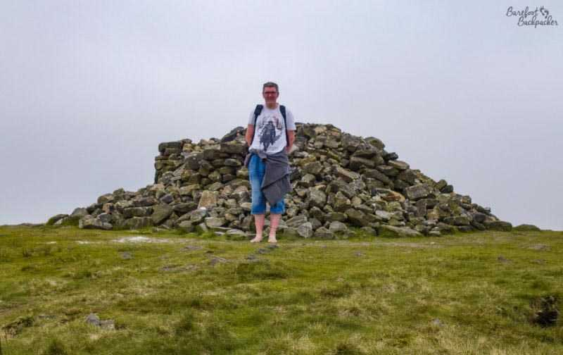 Two Lads Cairn, Winter Hill, with barefoot backpacker