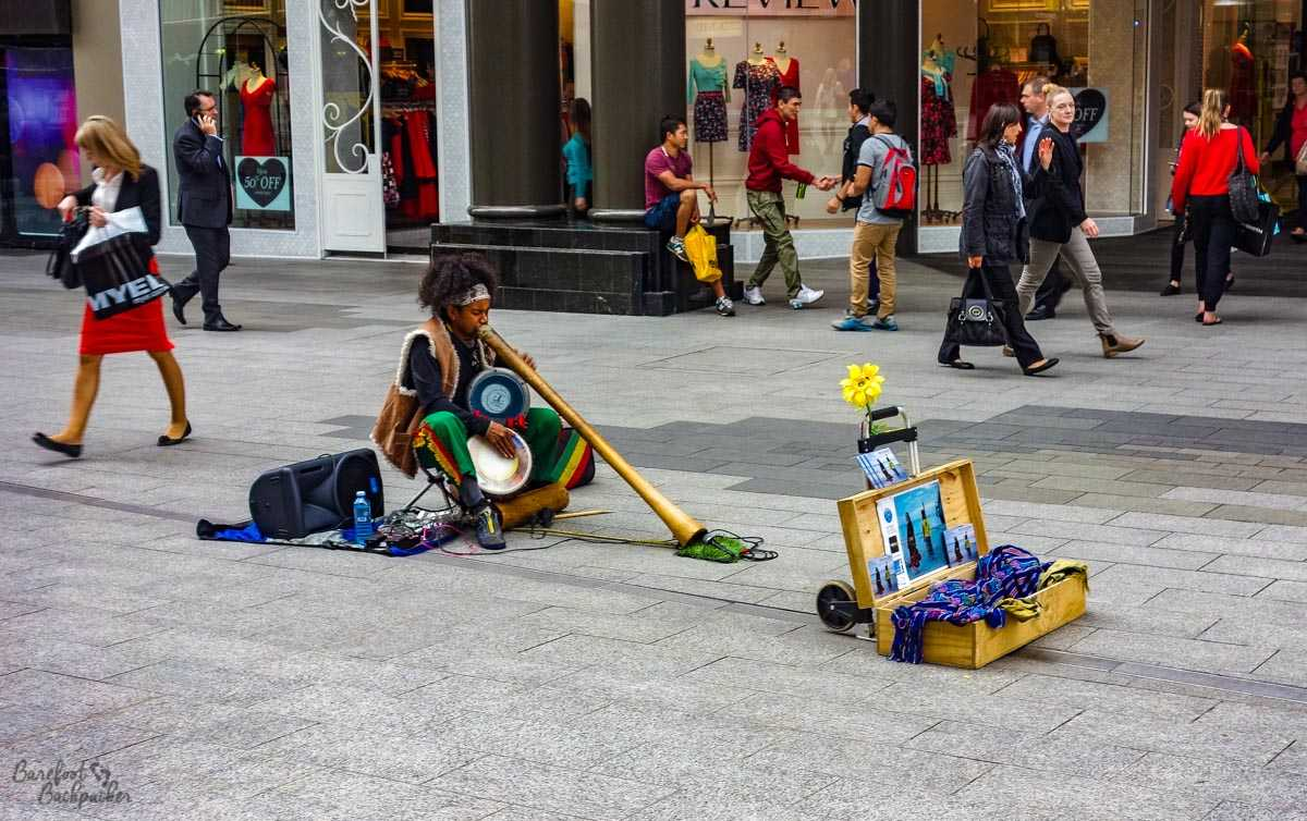 Man playing music on the street in Adelaide.