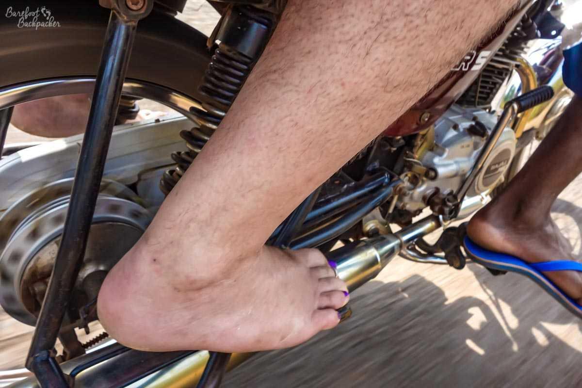 Barefoot on a motorbike in Benin.
