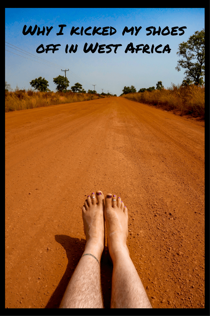 Barefoot on a road in Ghana.
