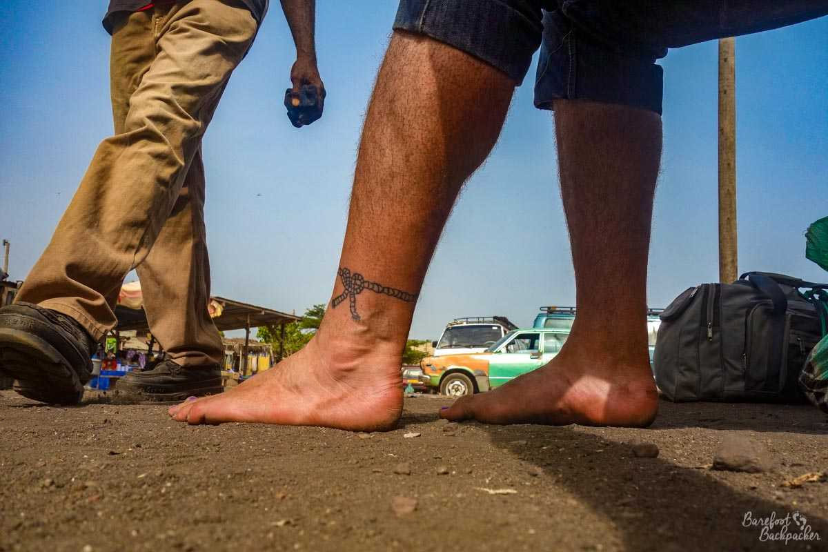 Barefoot at a bus Station