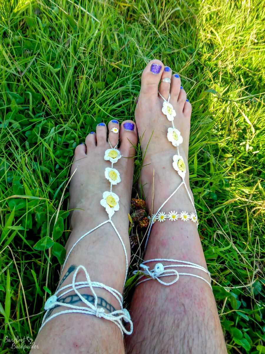 Traditional barefoot sandals in the grass
