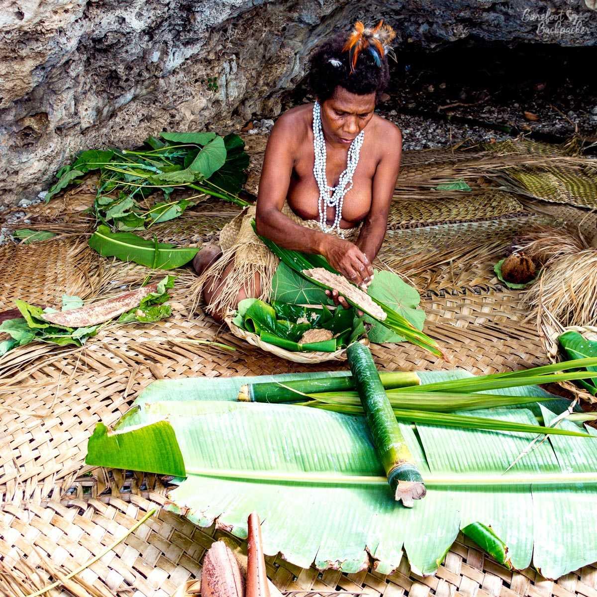 A tribeswoman making laplap.