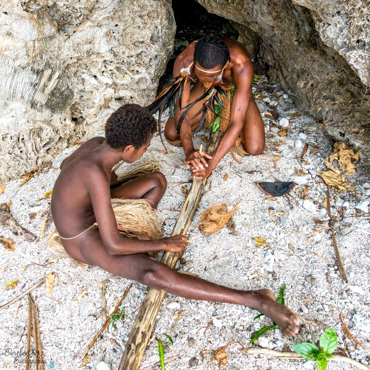 Tribesmen making fire.