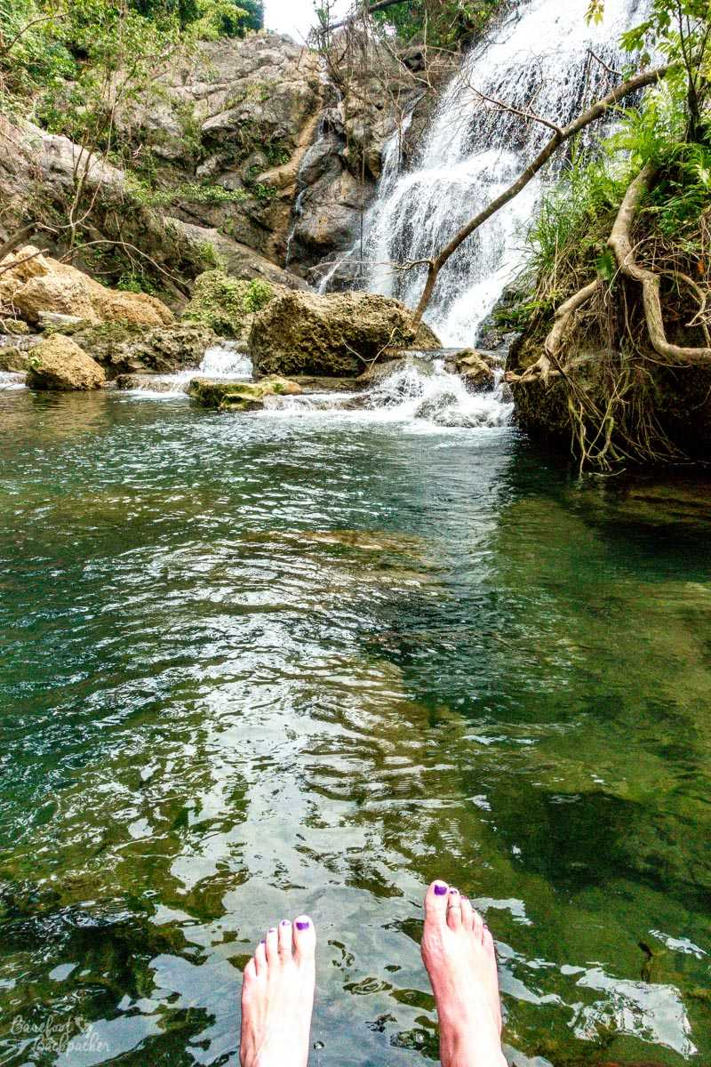 Bare feet in front of Losinwei waterfall, Malekula.