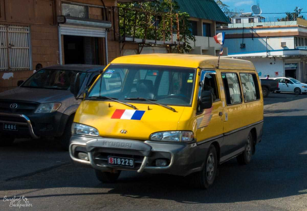 Minibus on the streets of Port-Vila, with French flag.