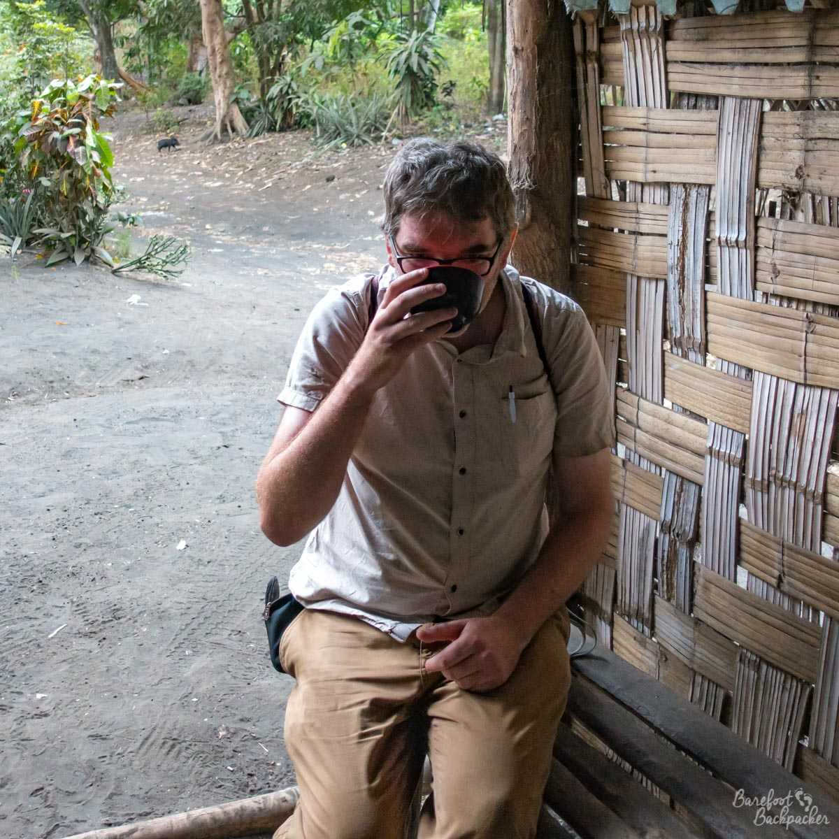 The Barefoot Backpacker drinking kava.
