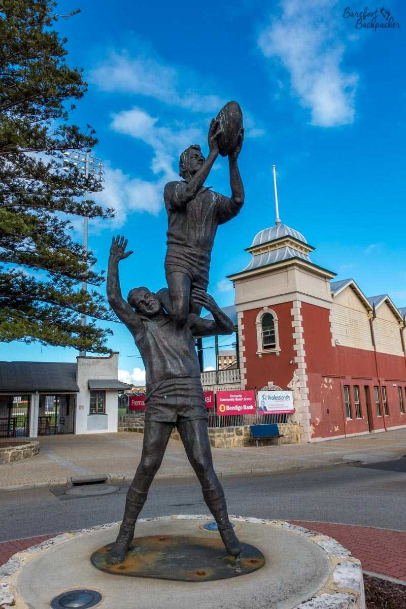 Statue of an AFL 'mark', outside the Fremantle Oval.
