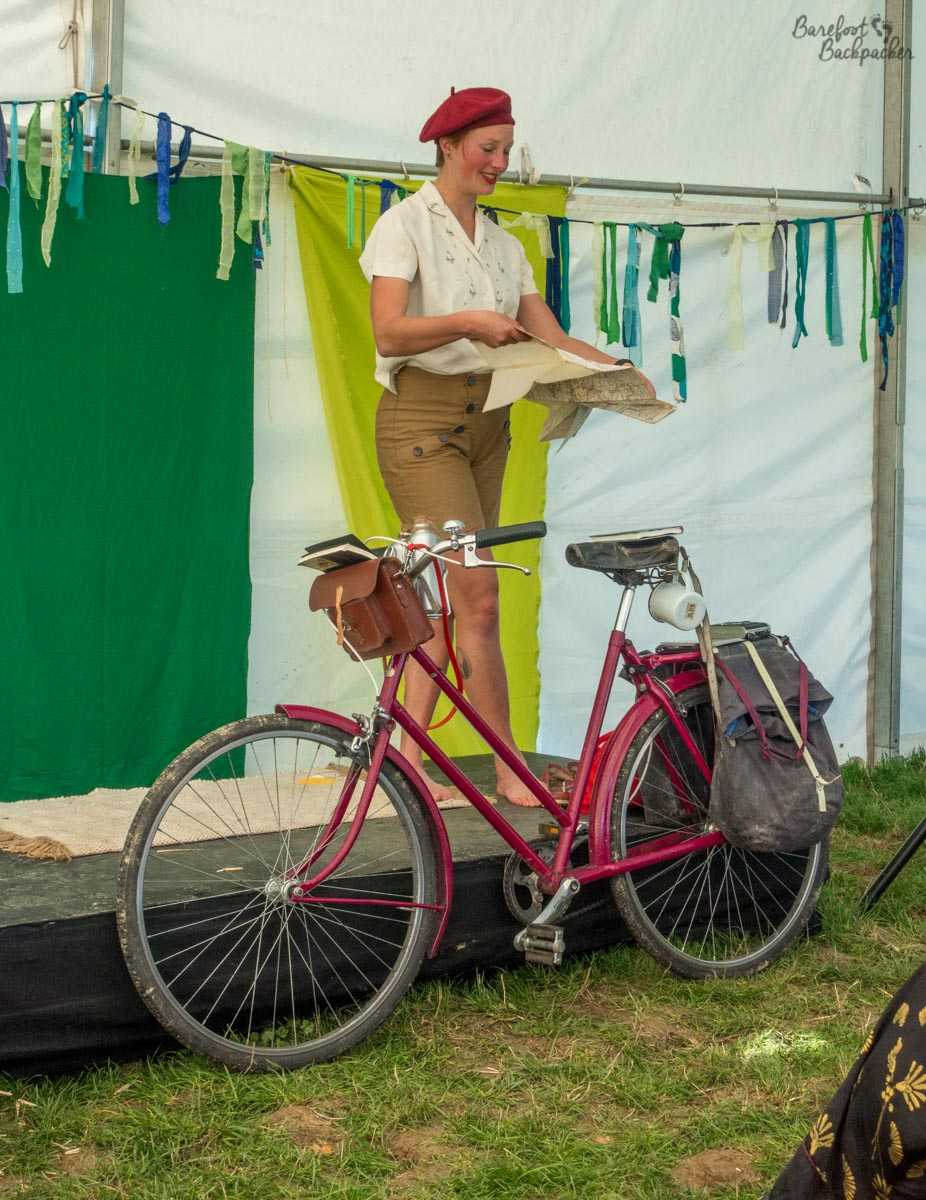 Helen Proudfoot at Yestival displaying her 1940s bicycle and style.