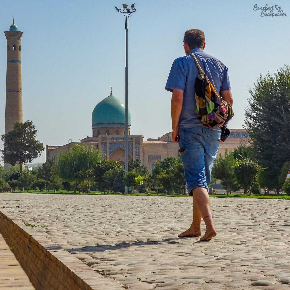 The Barefoot Backpacker, walking in the Hazrati Imam complex in Tashkent - Islamic architecture abounds, with colourful tiles and minarets.
