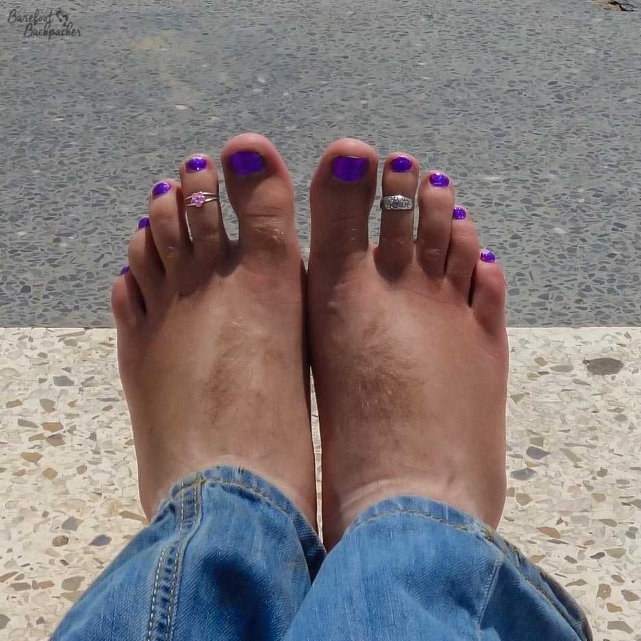 The Barefoot Backpacker's feet, complete with purple toenails, at the start of his West African adventure