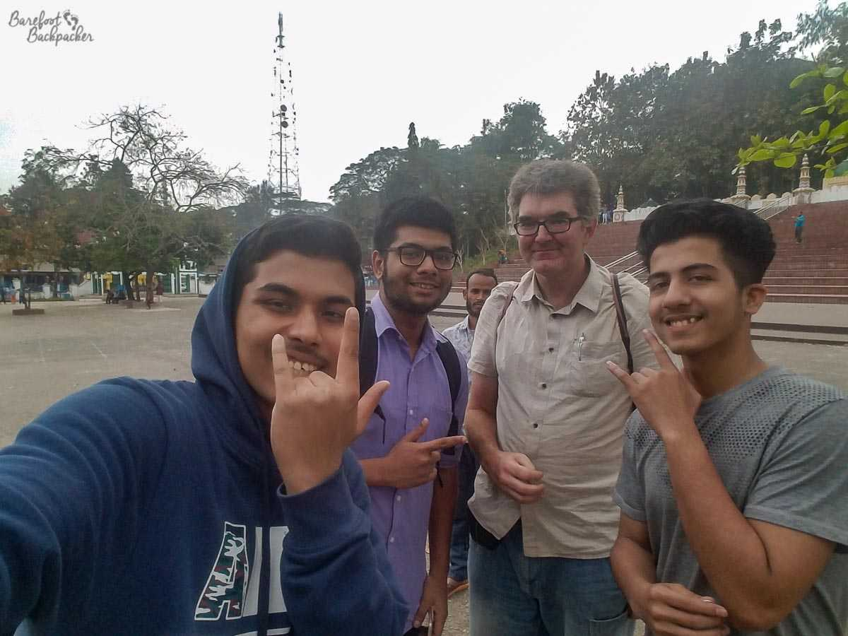 Local students from a college in Sylhet posing for a selfie with me.