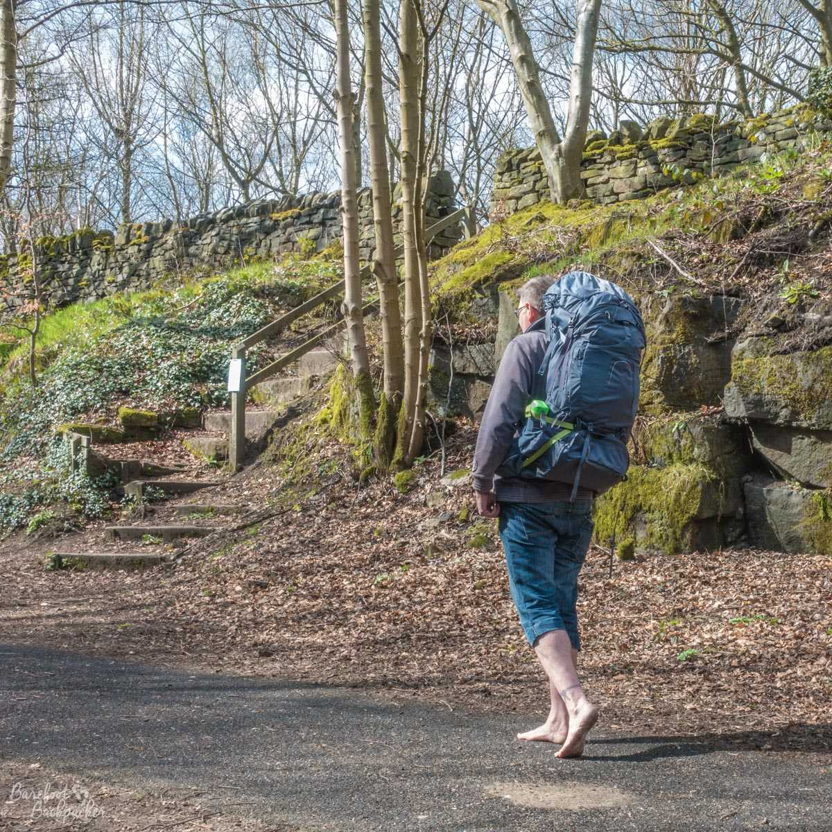 Hiking barefoot with a huge packpack along the Trans-Pennine Trail, near Penistone, Yorkshire