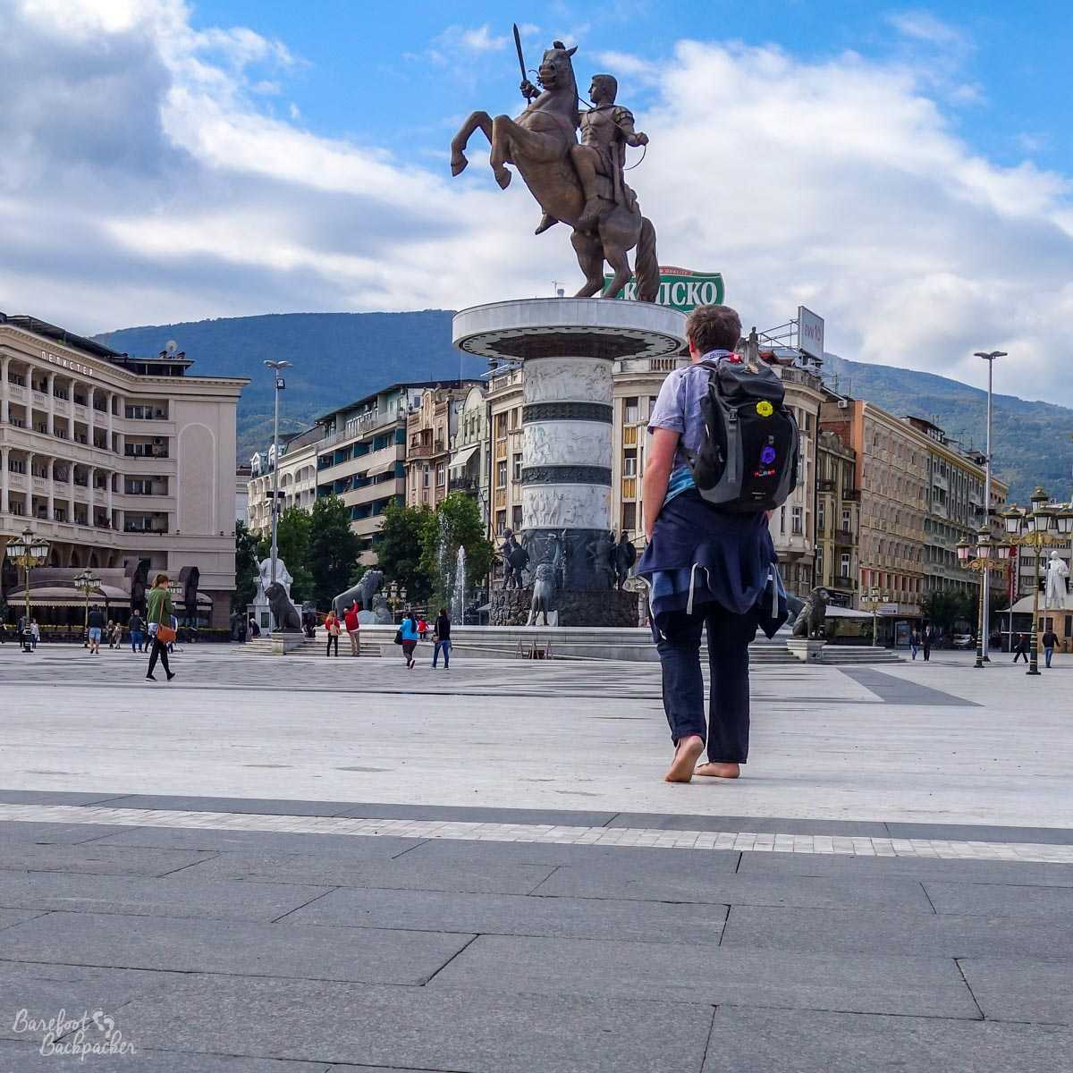Standing barefoot in the main square of Skopje, North Macedonia