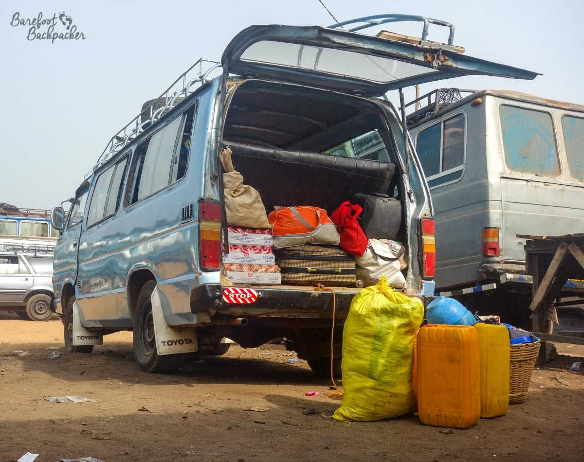 The minibus I took from Togo to Ghana – silvery, bashed up, and full of cargo.