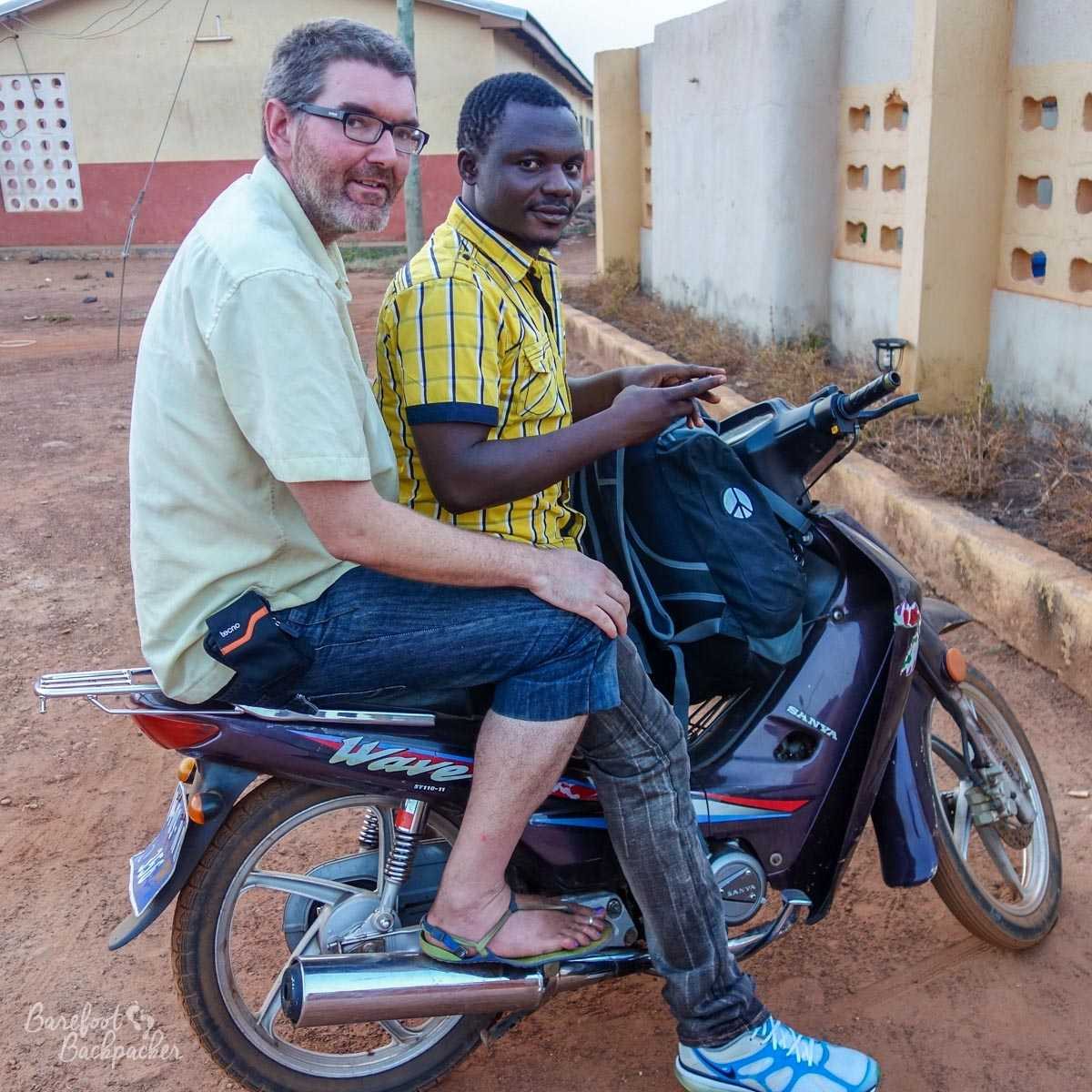 The moto-driver in Tamale, Ghana, together with the Barefoot Backpacker. Who is not barefoot at this point.