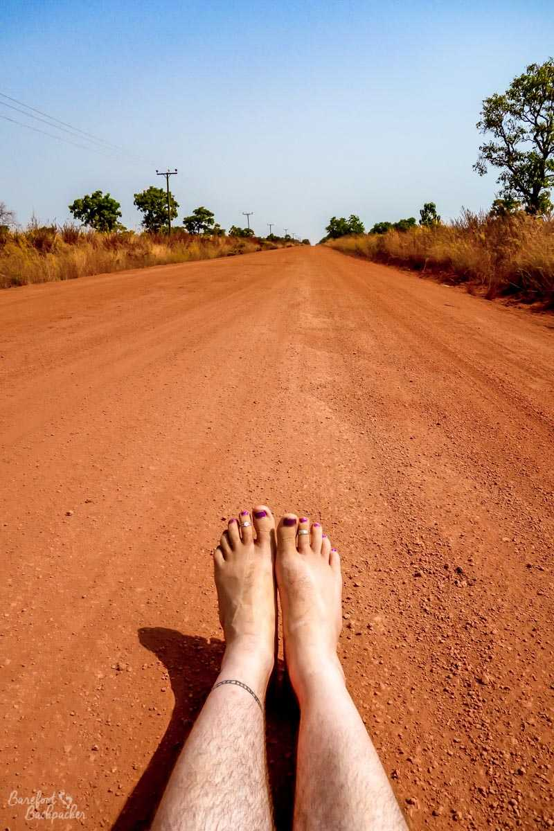Barefoot on the orange, gravelly, dusty roads of Ghana.