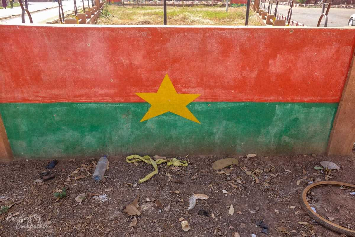 The flag of Burkina Faso, painted on a concrete barrier.
