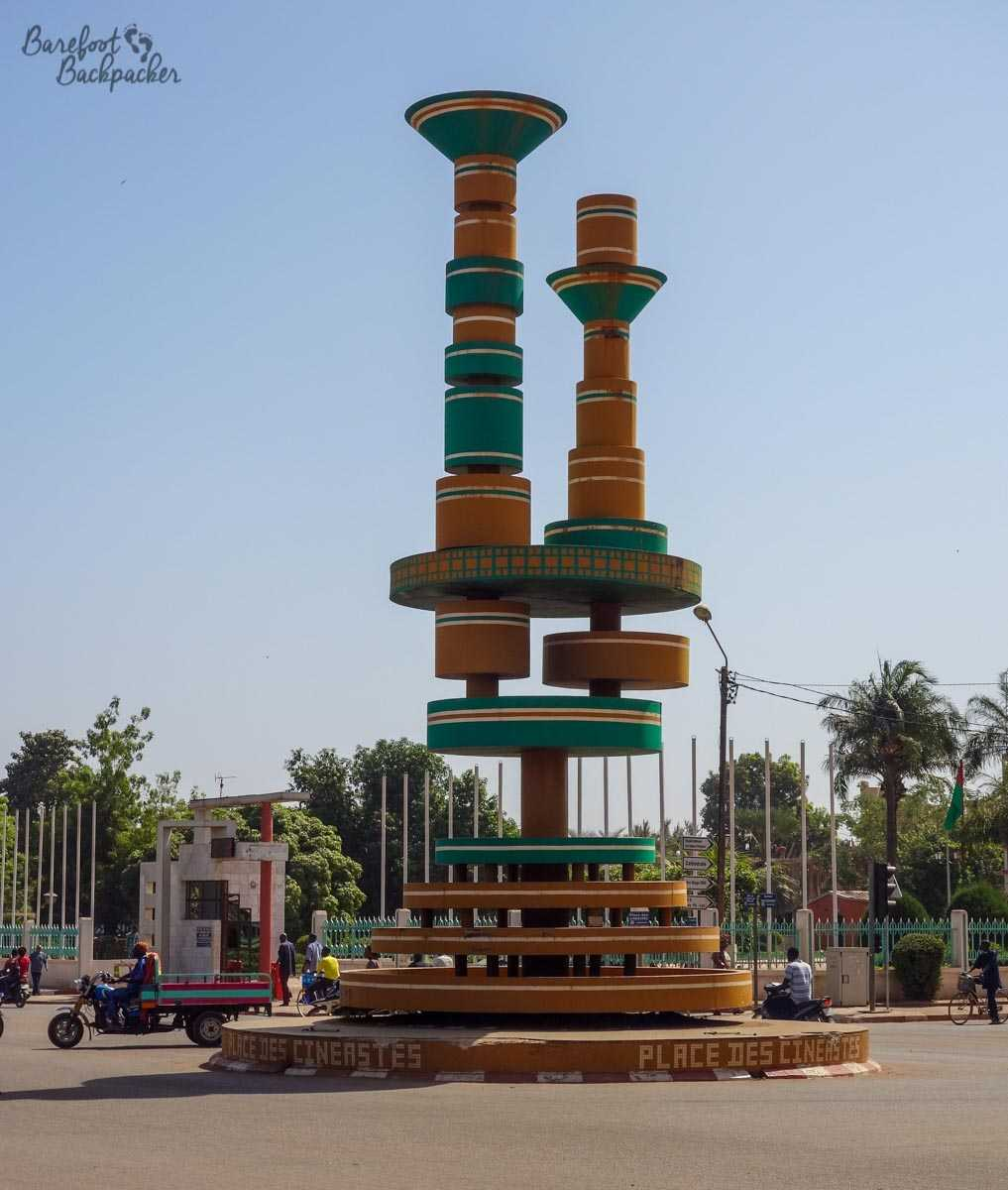 Odd sculpture at Place des Cineastes, Ouagadougou, Burkina Faso. Towers that look like they're made of children's shape toys.