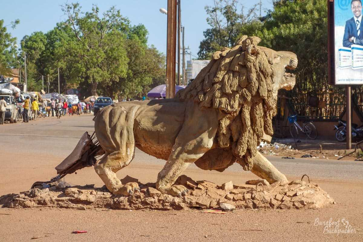 Stone lion in the road junction, Fada-N'Gourma, Burkina Faso.