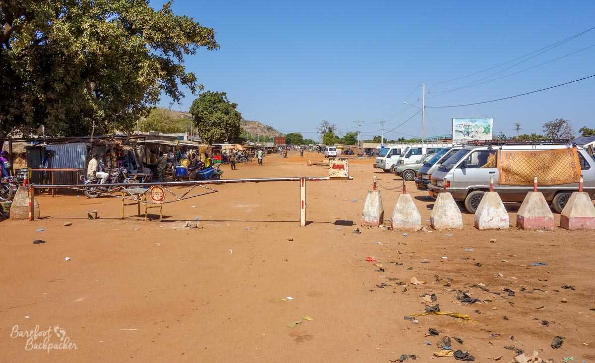 The car park and roped-off road at the Burkina Faso border post on the way to Benin.
