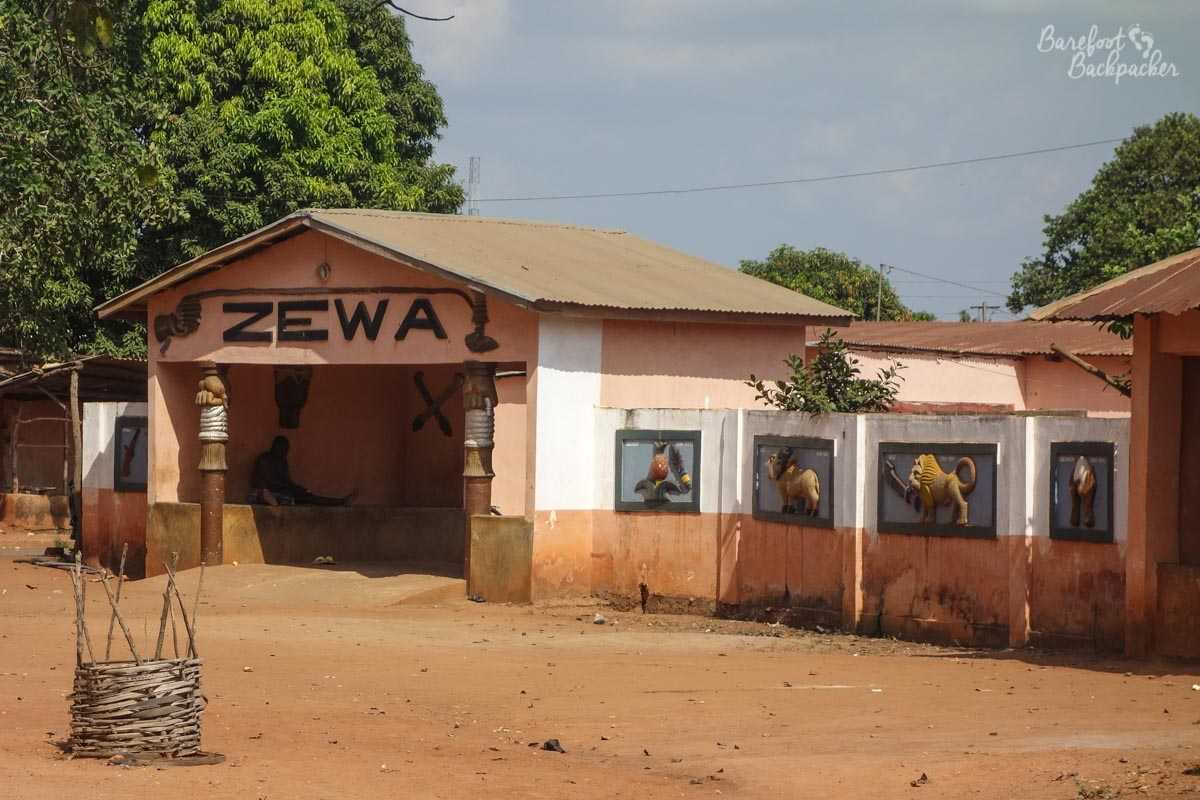 Zewa Temple in Abomey, with symbols of the Kings of Dahomey on the wall outside.