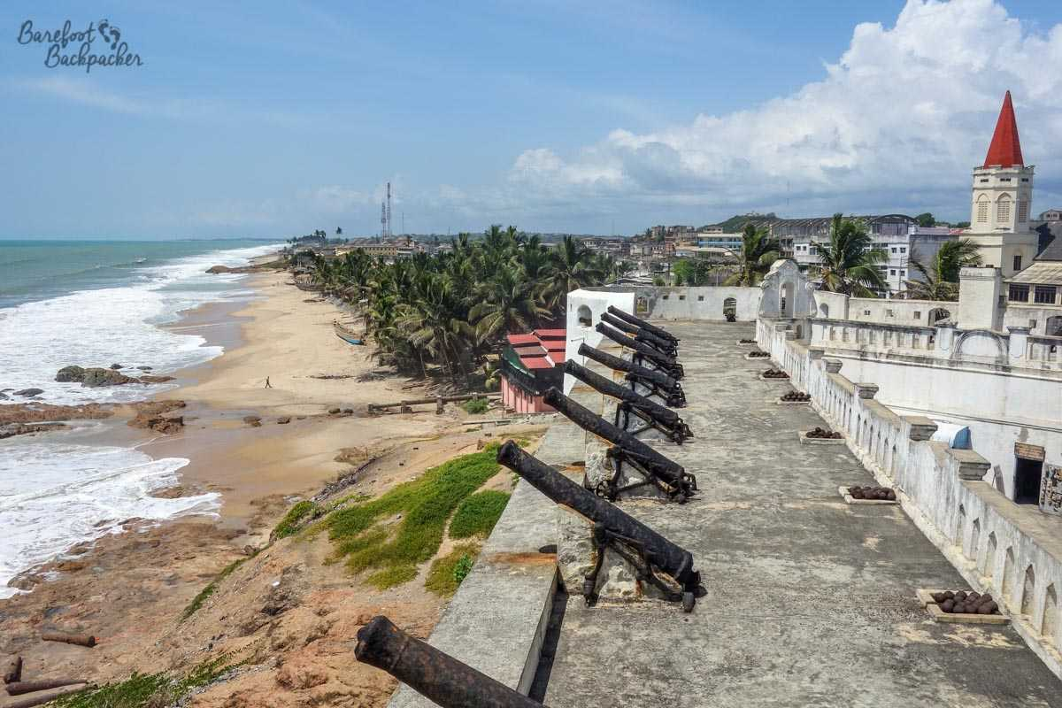 Cape Coast Castle, Ghana. This view is of the upper battlements, overlooking the sea. To the right are the cannons and cannonballs used to defend the castle from invaders.