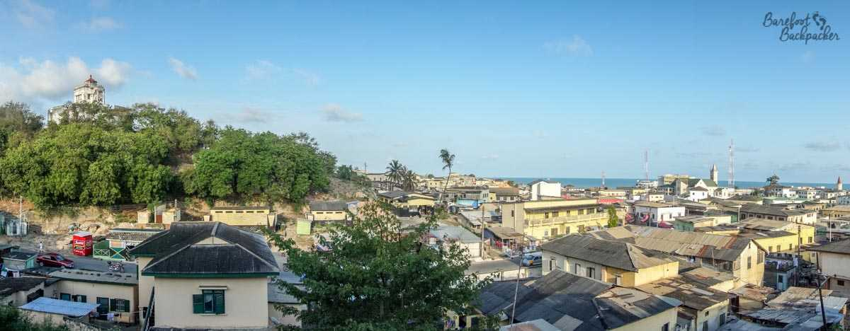Overview of Cape Coast, Ghana, including one of the forts (possibly Fort William) and a panoramic view of the town itself.