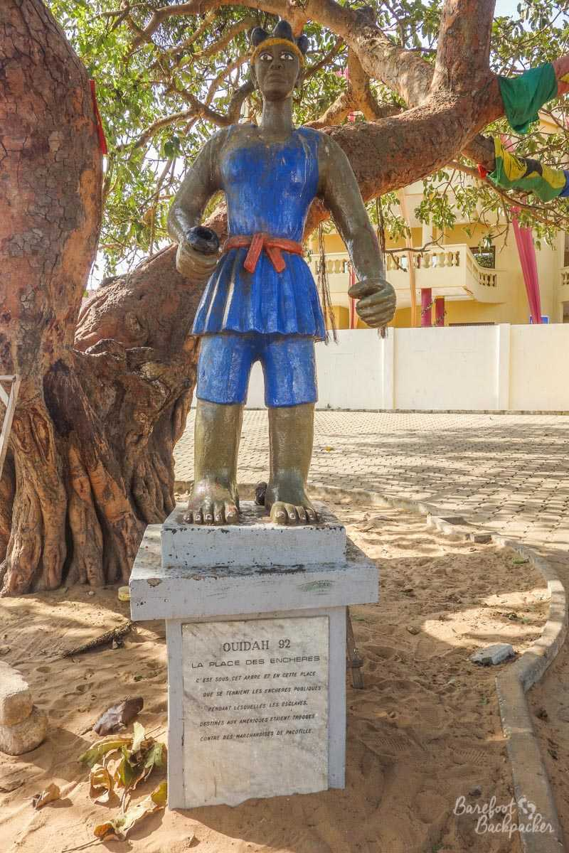 Statue in the main square of Ouidah – it's of a typical local, and the inscription below is in French but basically says 'underneath this tree is where slaves destined for the Americas were bought'.