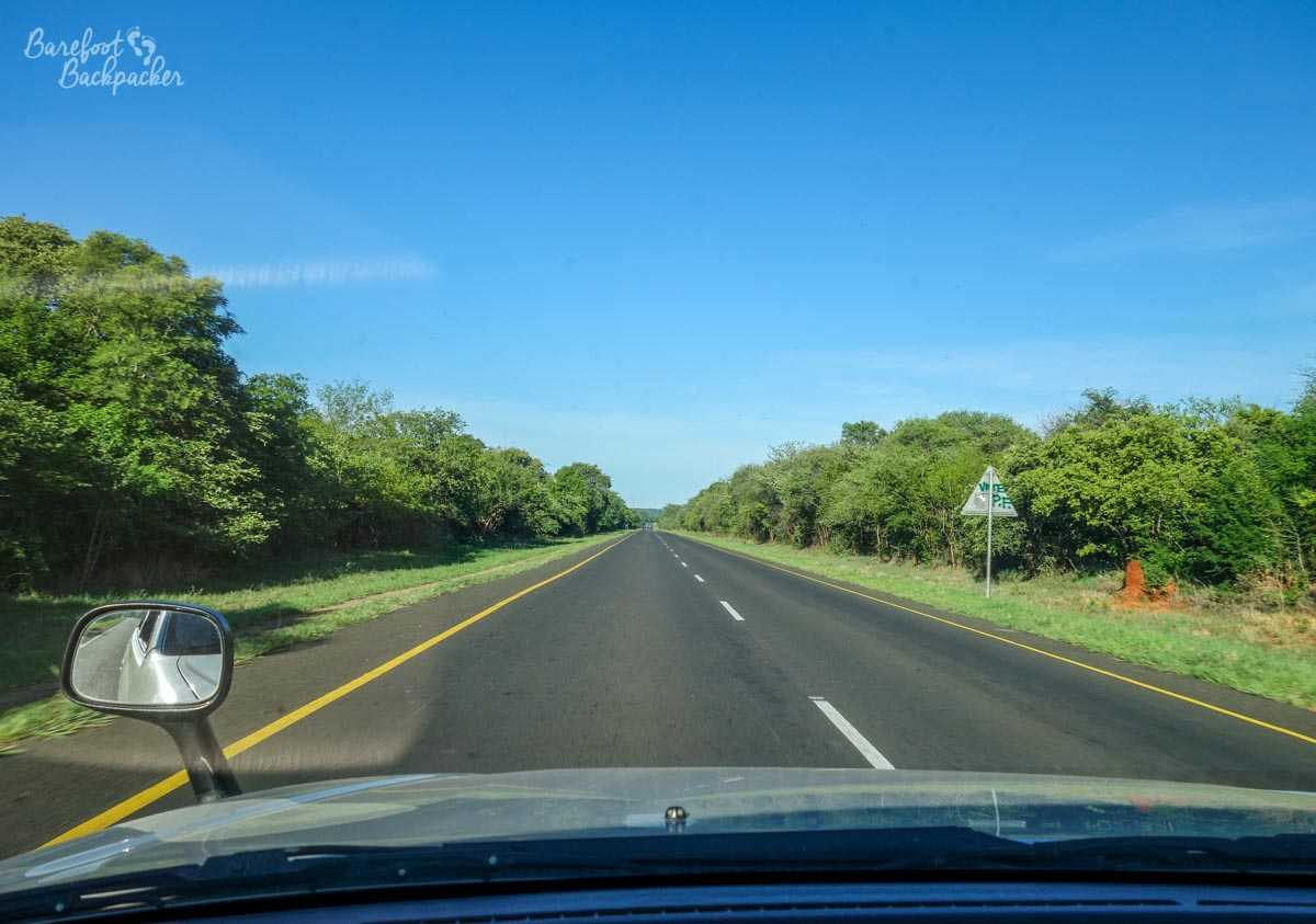 The Zambian countryside, New Years Day, on the way to Botswana. Beautiful clear blue skies and tree-lined road