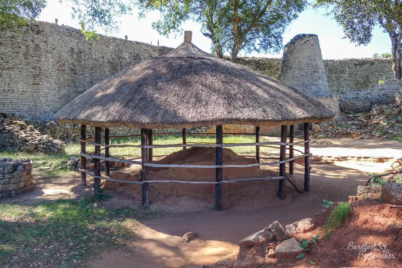 Stone ruins in the Great Enclosure complex at Great Zimbabwe. A meeting or heating rondavel in the foreground, and the large conical tower behind