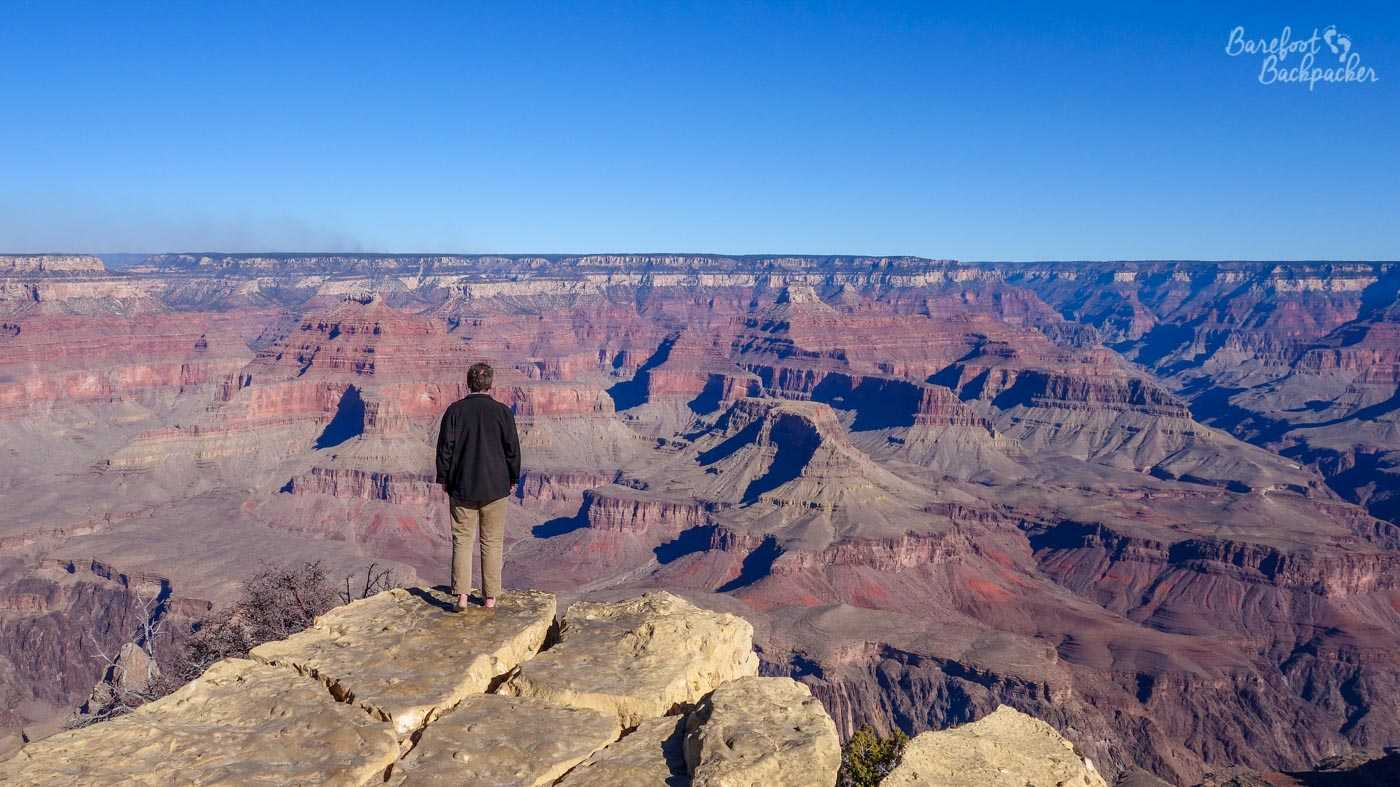 Imagine a world with clean air, clear skies, beautiful scenery, and a feeling of remoteness, one where a lone human stands small in the face of a huge landscape stretching on all sides, including down. So it is with this image - one man (me!) standing in front of the Grand Canyon, he's almost invisible in the scenery.