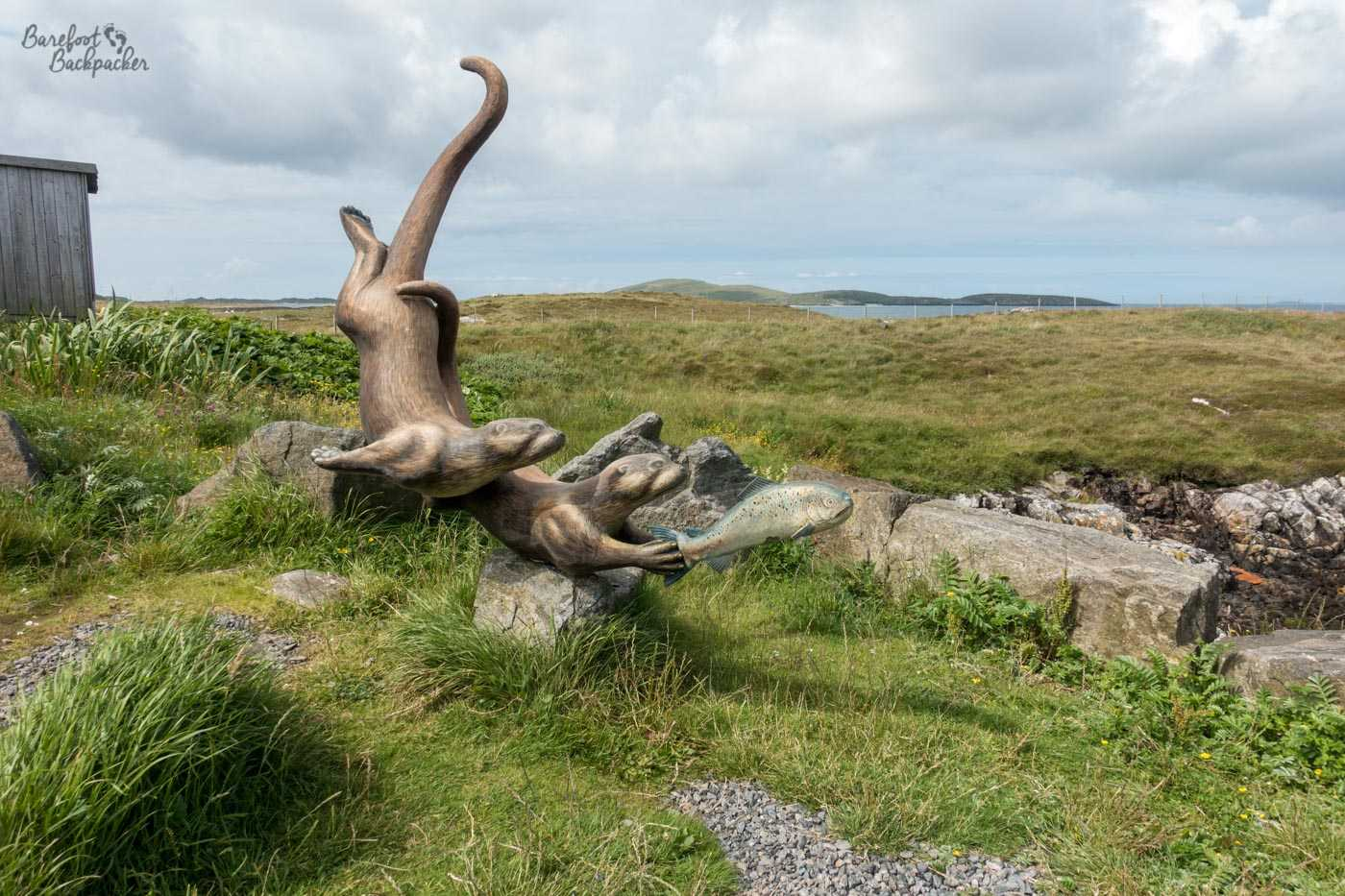 Sculpture of otters located by the northern ferry terminal on Barra, on the way to Eriskay.