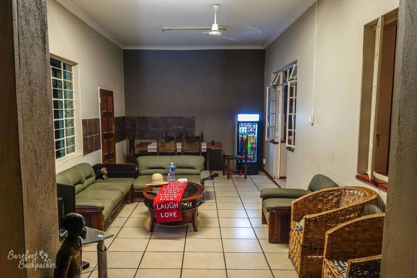 The main lounge of the hostel/B&B in Musina; sort of the missing link between homespun and student-functional.