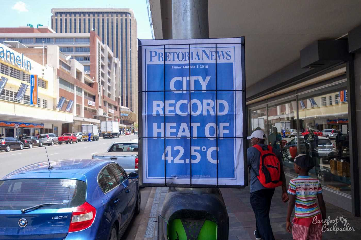 Poster in Pretoria highlighting the weather – 42°C!.