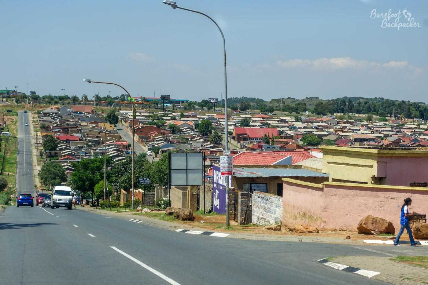 Overview of part of Soweto, looking out over some of the houses from a street in the outskirts