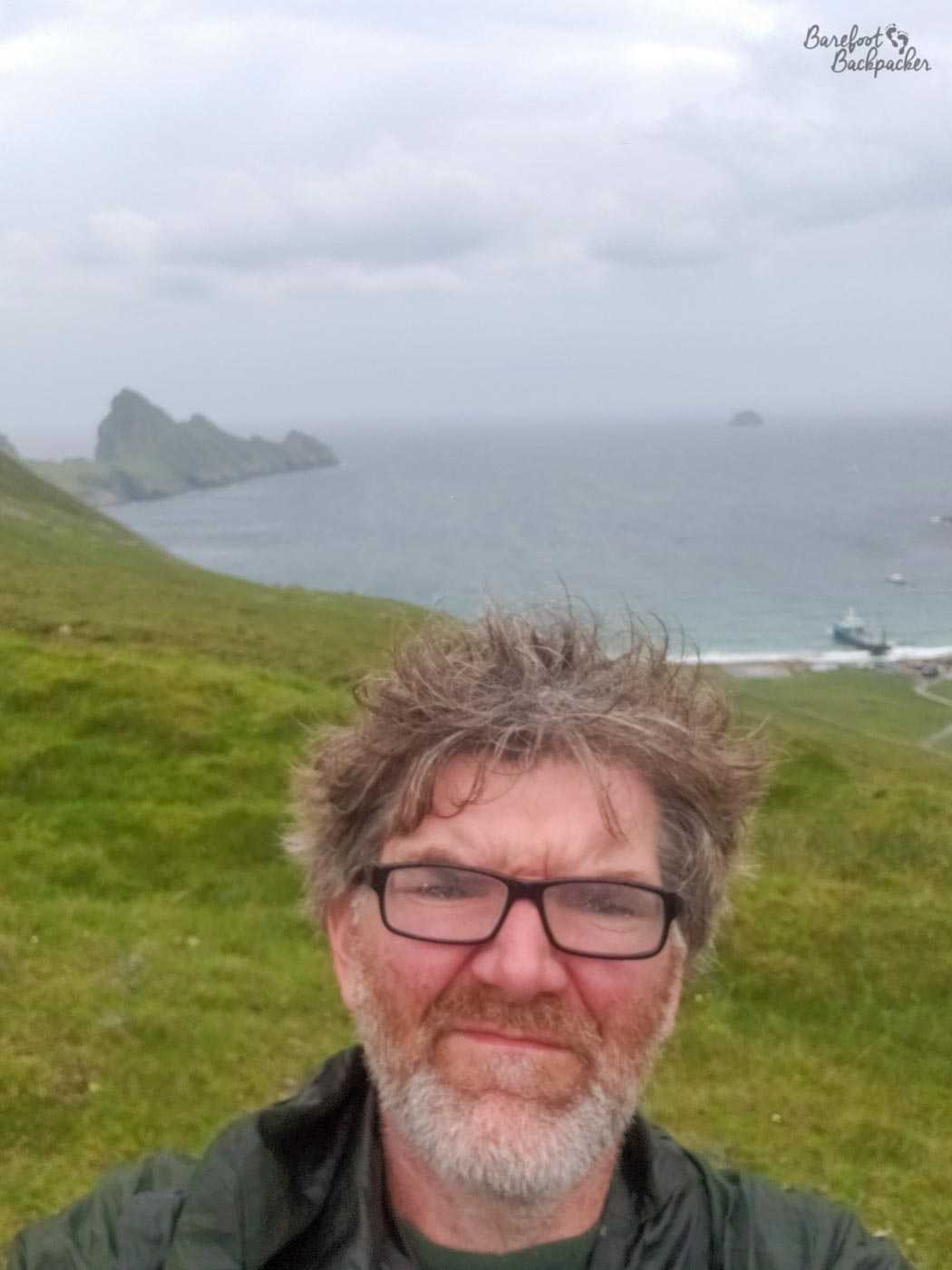 A selfie of me (The Barefoot Backpacker) taken atop one of the hills on Hirta. My visit coincided with the hottest day yet recorded in the rest of the UK. Here it was about 17°C, force 5 gales, and quite damp. Needless to say it was *not* the hottest day yet recorded here in St Kilda.