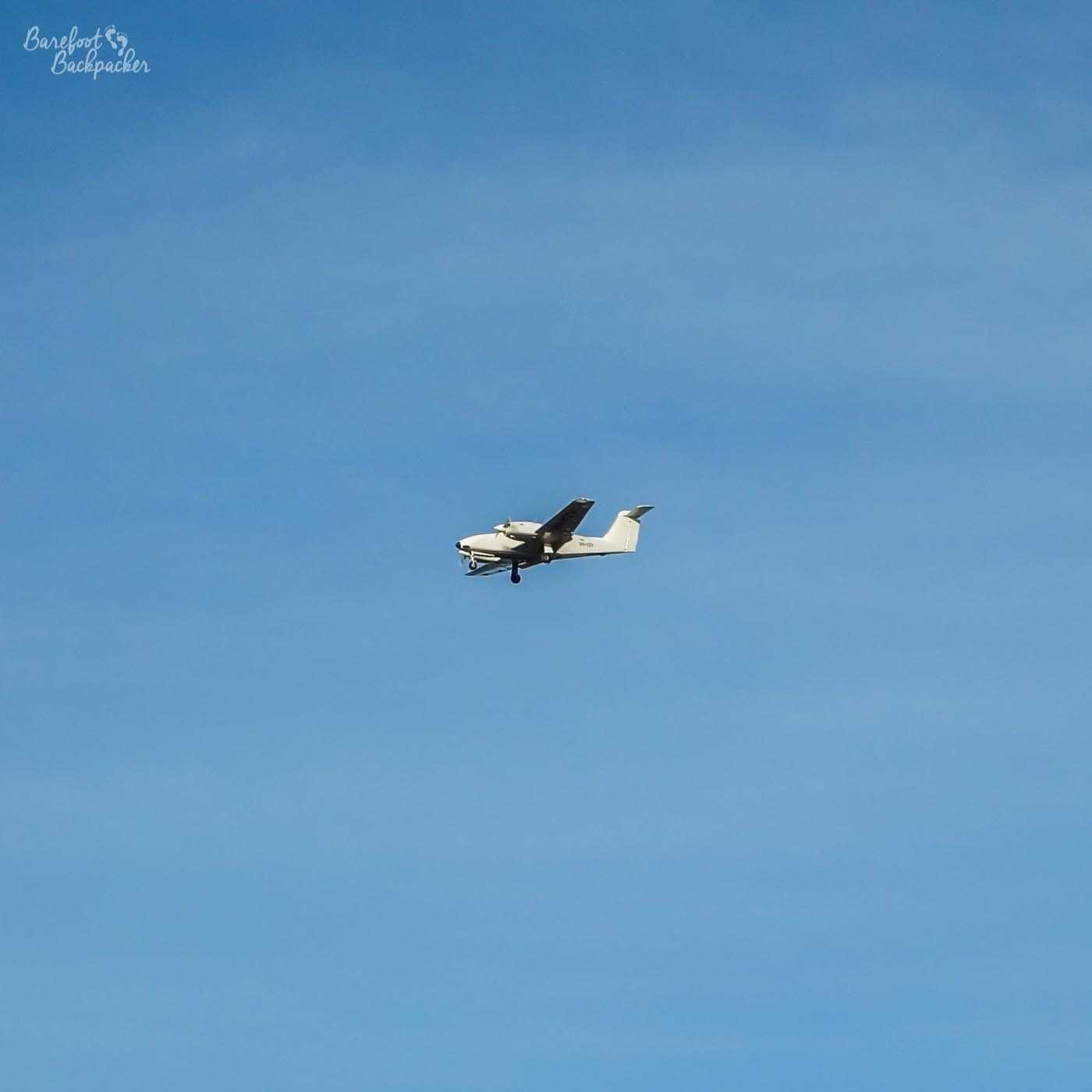 A small plane flying in the blue sky over Rottnest Island