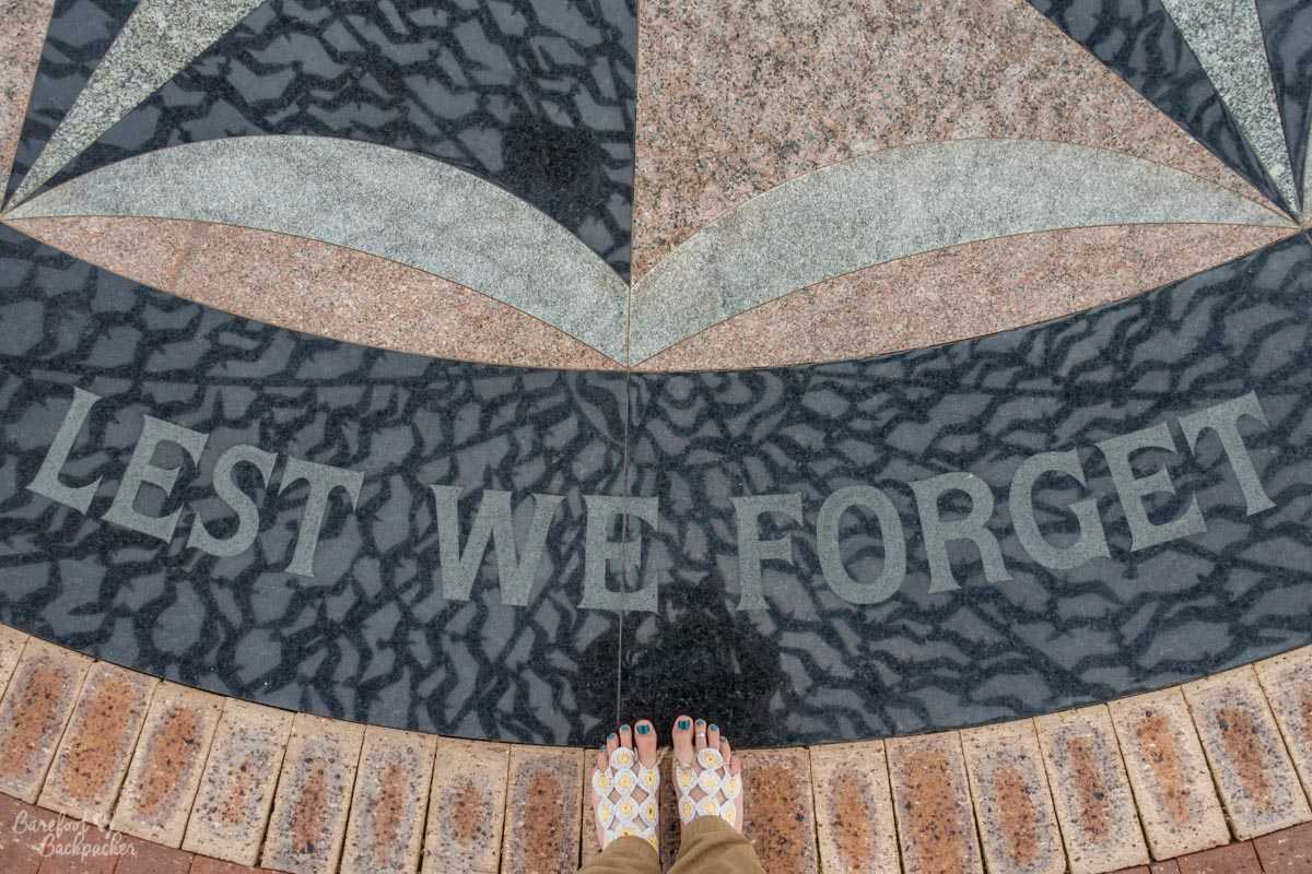 On the ground at the HMAS Sydney Memorial is a simple suggestion – Lest We Forget.