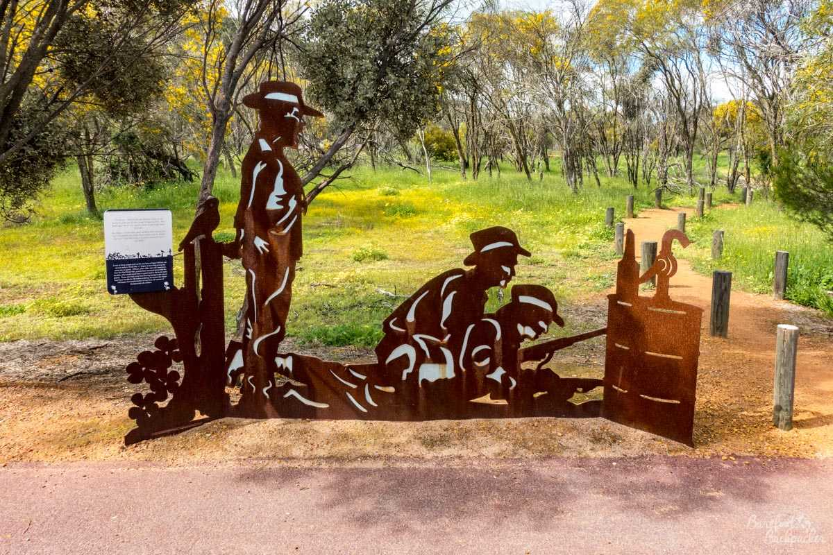 The entrance to Depot Hill; a metallic silhouette sign of soldiers with guns.