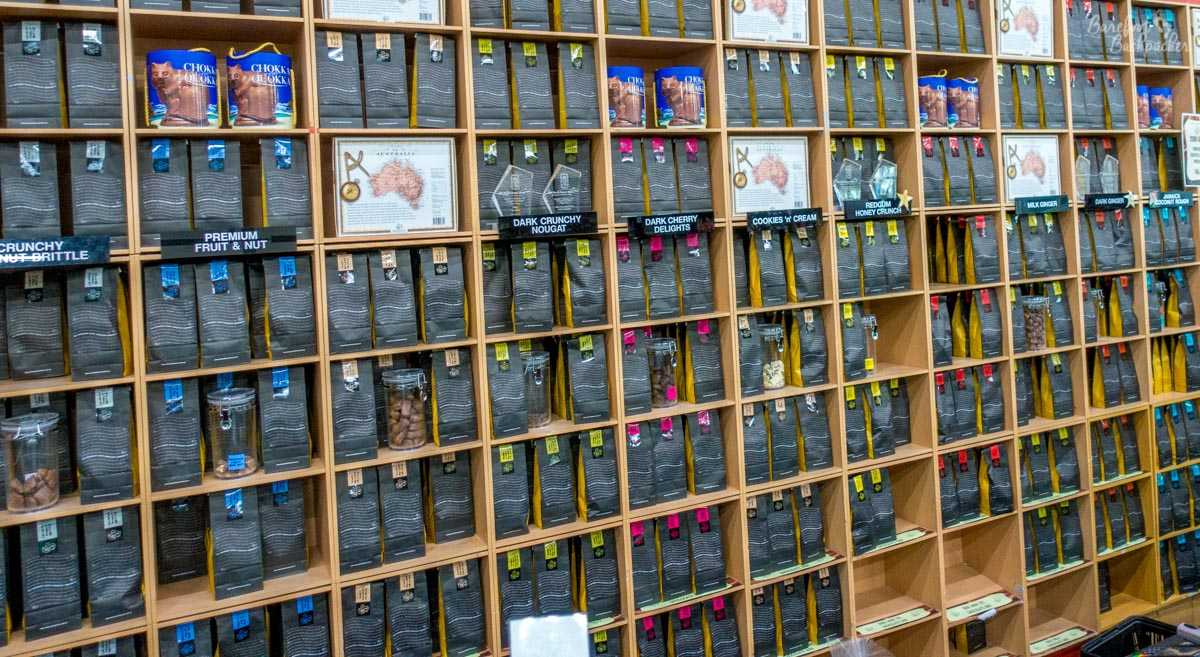 A whole wall of shelving filled with different flavours and types of chocolate, at Margaret River Chocolate, Swan Valley.