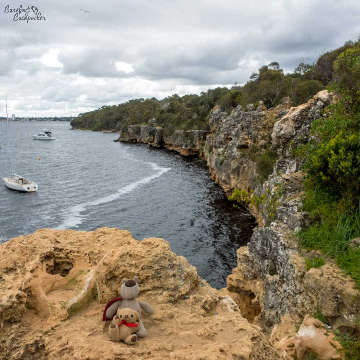 Overlooking the cliffs on the edge of the Swan River, near Melville, Western Australia. In the foreground are my travel companions Baby Ian and Dave. Because who can forget they exist?!