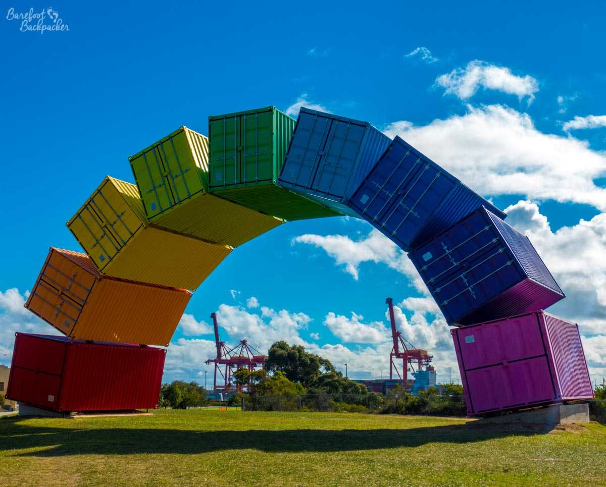 The rainbow art installation, made up of shipping container crates painted in the colours of the rainbow./></noscript><br /><font size=1>The 'Rainbow' container crate installation.</font></center></p> <p>Being based in the suburbs rather than the town also meant I had the chance to explore neighbourhoods it wouldn't have occurred to me to do on my previous visit. One such opportunity I took was to take a walk along the Swan River near the suburb of Melville, heading inland towards Perth.</p> <p><center><img src=