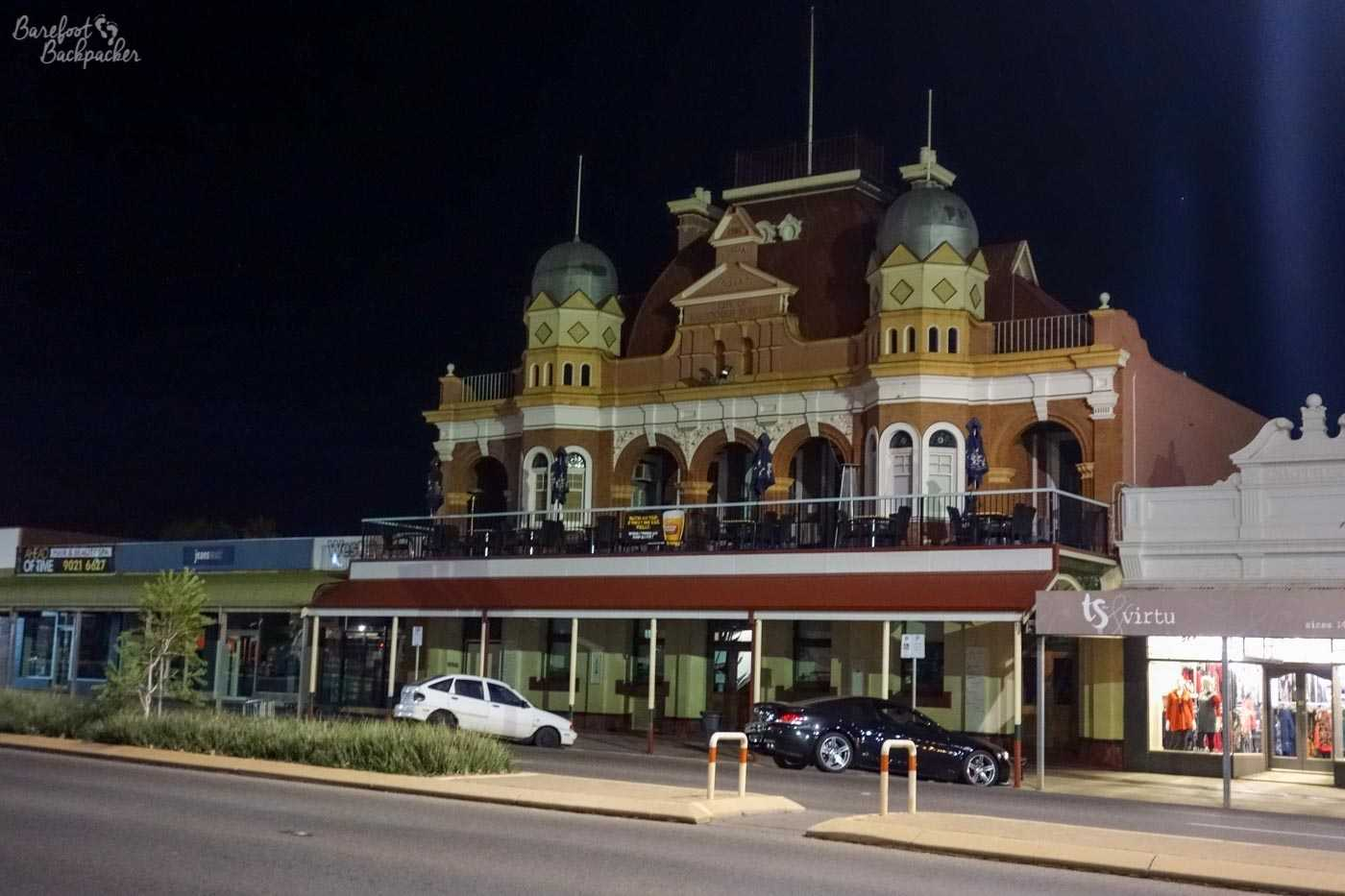 The main street in Kalgoorlie – shops and a pub. The shops are all one storey high but the pub, that's a pretty ornate, almost church-like edifice, built on top of the one storey ordinary building, with two rounded towers on a balcony either side of a Victorian-era frontage and a taller tower with an aerial on top. Odd.