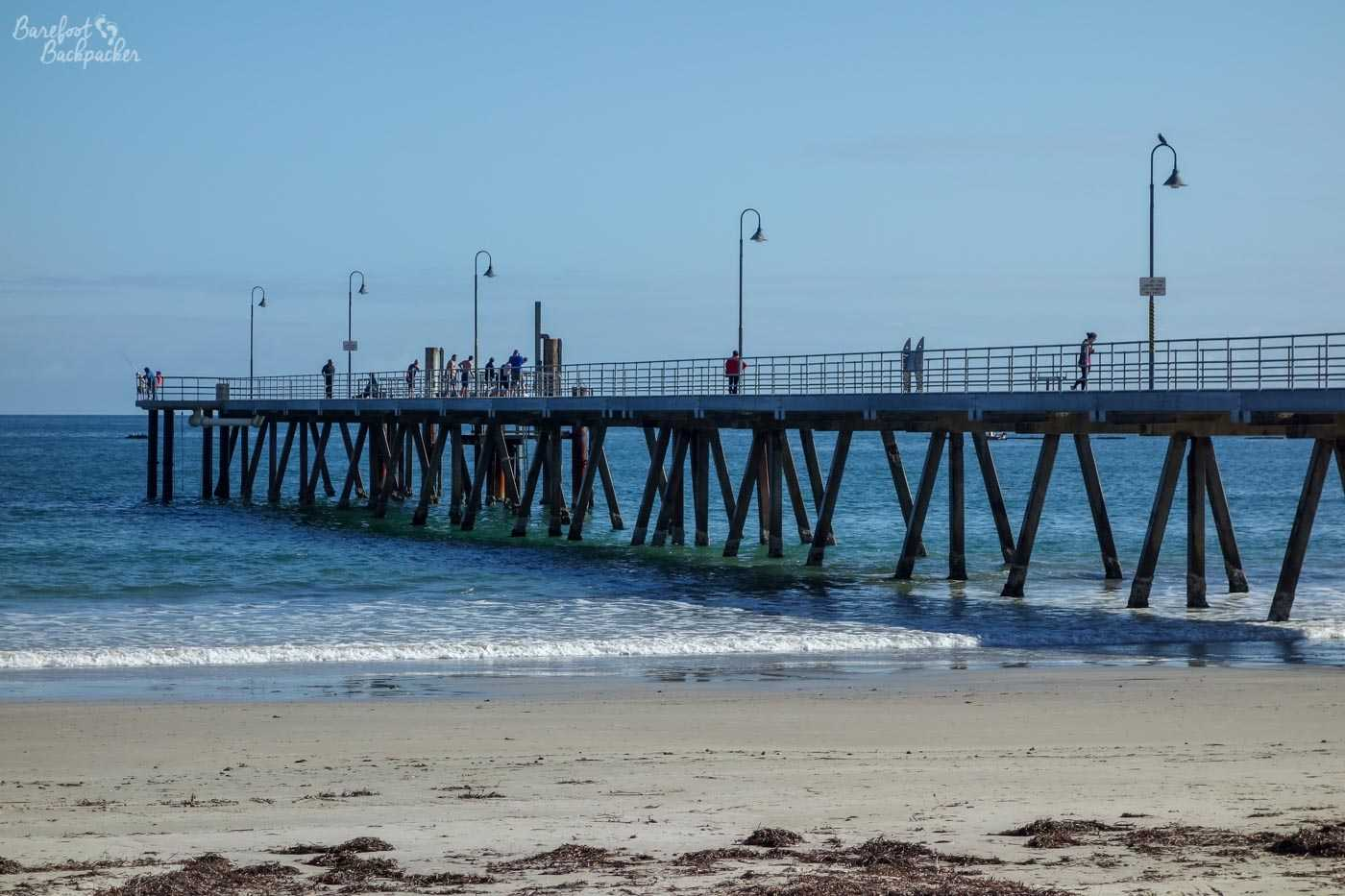 The pier at Glenelg, taken from the beach. It goes into the water quite a way. It's a wrought iron looking structure and, well, looks like pier. What more do you want from me?!