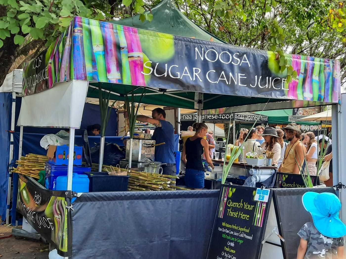A stall at the Eumundi Markets selling 'Noosa Sugar Cane Juice'.