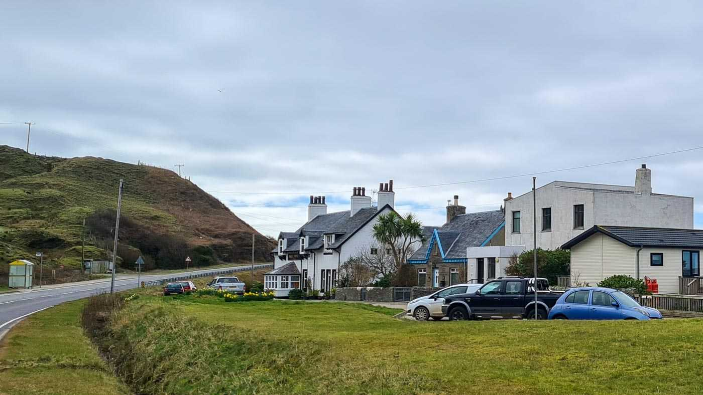 The Argyll Hotel, in Bellochantuy. It's a white building, sloping roof, on a side road and just off the main road as it curves to the right, stuck between the sea on the right and higher ground to the left. There's a couple of other buildings nearby but it's definitely in a remote place.