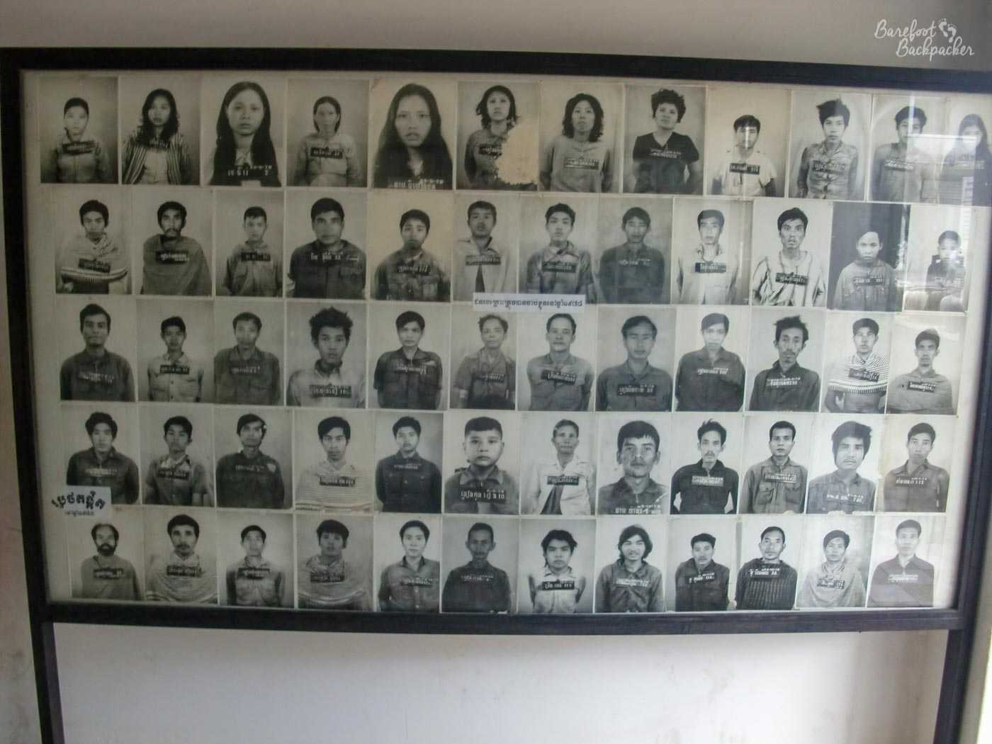 A large photo frame, with headshots and names, five down and twelve wide, in black & white, displaying a small selection of some of the people who were processed here. And presumably killed here.