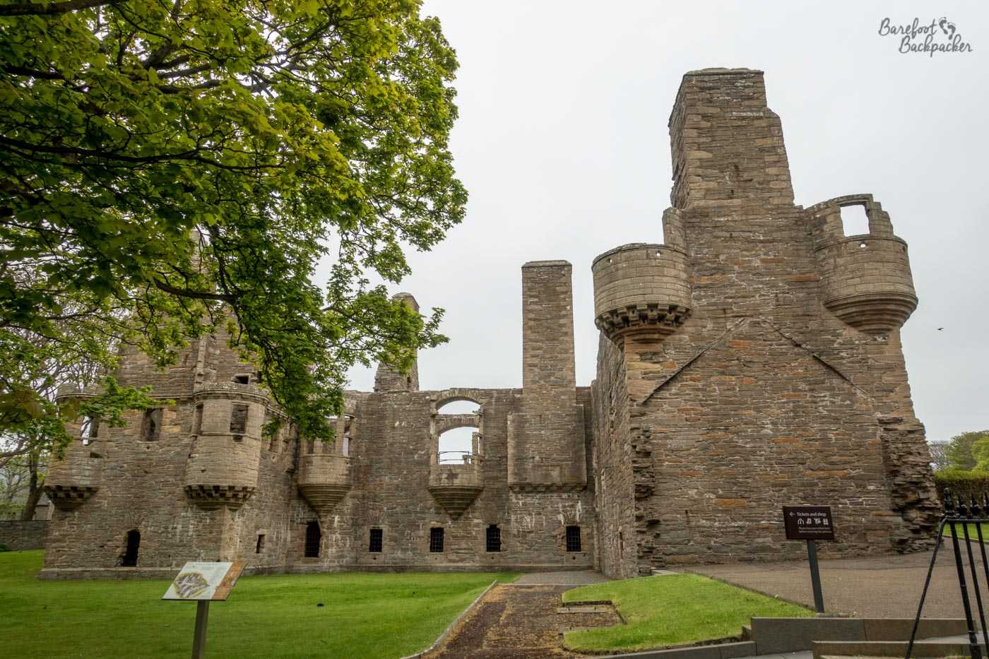 The ruins of the Earl's Palace in Kirkwall. It has the same vibe as an old stone castle, with rounded towers and a stone frontage.